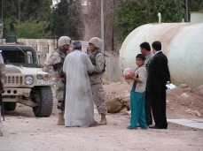 My friend Bryan and a translator confer with a local Iraqi as we conduct post-combat reconstruction efforts in Samarra, a city, 11 years later, that is still a bloody battleground. The man in the suit is dead. The man next to him was once kidnapped and threatened with beheading. Bryan and I had decided to use money we controlled to ransom him, however he was released. Whether he was actually kidnapped is something I could never completely determine, such were the alliances and personalities that existed in the midst of guerrilla and civil war, corruption, and collapse. The boy with the soccer ball...he would be in his twenties now, is he alive, a refugee, an amputee? PTSD, nightmare, depression, chronic health problems most definitely. Does he fight for the Islamic State now out of necessity, survival, hatred, faith...I don't know, but I would guess, yes, it is very possible he does.